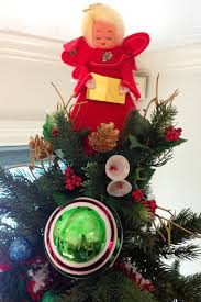 Tradtional Vintage Angel Tree Topper On A Green Christmas