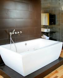 Freestanding tub with wall mounted faucet