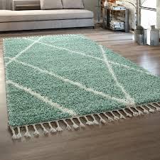 hochflor teppich wohnzimmer shaggy skandinavischer stil mit fransen grün creme