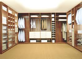 modish brown wooden finished built in u shaped walk in closet