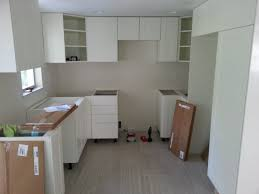 brown top white cabinets white granite countertop island white