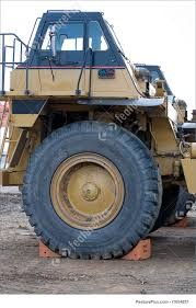 100 Large Dump Trucks Tools And Supplies Operators Cab Of Dump Truck Showing Huge Front Tire