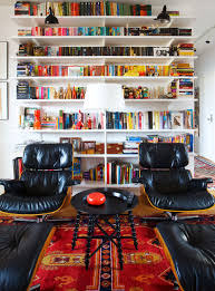 Eames Lounge Chair With Bookshelves Eames Lounge Chair Ottoman Armchair Vitra A Colorful And Eclectic Brooklyn Apartment Home Tour Lonny Replica Vintage Brown Walnut Fniture 9 Smallspace Ideas To Steal From A Tiny Paris By Charles Ray 1956 Pnc Real Estate Newsfeed Lovinna Storage Unit Esu Shelf Stock Photos Herman Miller The Century House Madison Wi Ding Portvetonccom