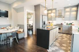 gray kitchen cabinets with white and gray concrete hex tiles