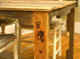 Stamped Boards From Shipping Pallets Feature Prominently In The Dining Table Design