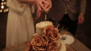 Couple Cut The Wedding Cake Rustic Outdoor