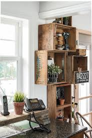Stacked Vintage Crates And A Reclaimed Wood Shelf For Rustic Kitchen Phone Station Against White