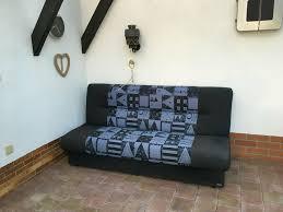 klappsofa gästebett sofa tv wohnzimmer bett schwarz lila