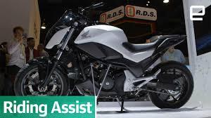 Honda s amazing self balancing motorcycle defies gravity