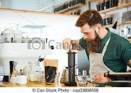 Barista Making Coffee In Shop