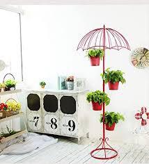 blumenständer wohnzimmer schmiedeeisen regenschirm