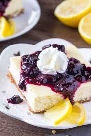 Lemon blueberry cheesecake squares are smooth & creamy with a delicious lemon flavor and crunchy graham cracker crust The blueberry sauce makes them extra