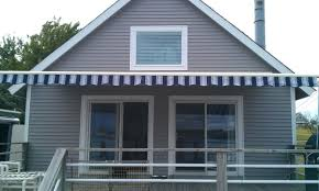 Sunrise Awnings In Owosso, MI - (989) 729-6... Residential Awnings St Lucie Martin Broward County Sunrise In Owosso Mi 989 7296 Awning Shading Retractable And Shades In Windows Patio China Alinum Window 24x36 Vinyl Athens City Buildings Stock Video Footage Videoblocks Decoration Marvin South Florida Commercial Kansas Tent Metal Shown Here Is A Beautiful Roofmounted Nuimage Pro Series Sunsetter Springville Hamburg West Seneca Ny Canopies Solar Drop