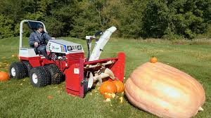 Fertilizer For Giant Pumpkins by Giant Pumpkin Vs Tractor Youtube