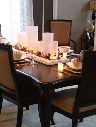 Unique Centerpiece Ideas For Dining Room Table With Plastic Stand Candle Also Varnished Chairs On White Fabric Rug Floral Pattern Window