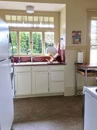 Laminate Countertop And Marmoleum Floors Transform Craftsman Kitchen