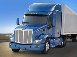 100 Prime Trucking School Purchases 900 Peterbilt 579 Tractors