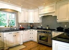 White Cabinets Dark Countertop Backsplash by Kitchen Backsplash White Cabinets Dark Countertop Black Granite