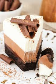 Triple Chocolate Mousse Cake a layer of dense chocolate cake chocolate fudge chocolate