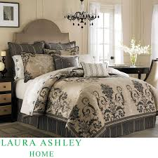 Laura Ashley Bedding In Tan And Floral Pattern With Brown Headboard On Wooden Floor Plus Carpet