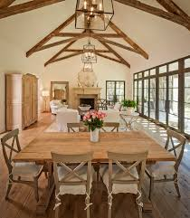 Stunning Dining Room Features Vaulted Ceiling Accented With Exposed Wood Beams As Well Iron And Glass Pendant Over Re Claimed Table