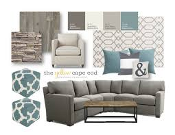 Grey White And Turquoise Living Room by The Yellow Cape Cod Family Cave Lower Level Basement Living