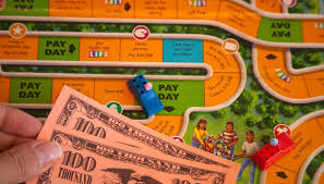 If A Player Passes Or Lands On Pay Day He Will Be Paid His Salary By The Bank Two Spaces One Turn