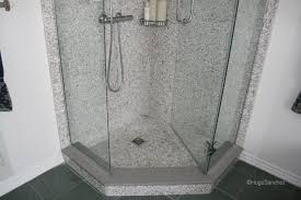 setting the drain with a pebble shower floor architecture