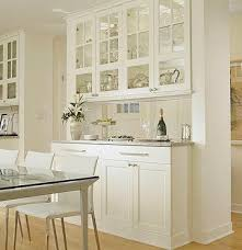 Glass Cabinets As Pass Through Built In On Dining Room Side Of Peninsula