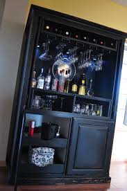 repurposed entertainment center into a bar check us out on