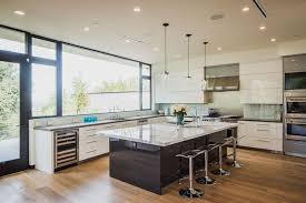 Modern Kitchen With White Lacquer Cabinets Dark Wood Island And Light Flooring