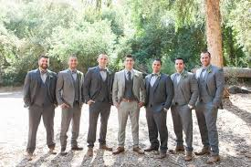 Groom In Light Grey Suit With Groomsmen Suits And Bow Ties Brown Shoes Rustic Wedding