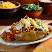 Chili-Topped Potatoes Recipe | MyRecipes 15 Frugal Meals For A Small Grocery Budget Baked Potato Bar Twice Potatoes With Bacon And Cheddar Simple Awesome Best 25 Ideas On Pinterest Potato Used A Fully Loaded Guide To The Ultimate Serious Eats Potatoes Baked Grilled Bar Platings Pairings Picmonkey Image 31 Office Lunch French Fry The Pioneer Woman Easy Skins Recipe Cwhound Sweet Healthy Ideas For Kids