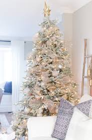 A Snowy Flocked Christmas Tree Decorated In Silver And Rose Gold Adds Big Dose Of