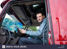 Happy Truck Driver Sitting In The Cab Of Red Truck Behind The Wheel ... 5 Industries Looking For Commercial Driving License Holders In Looking A Box Truck Driver Driver Hayward Ca Truck Mirror Stock Photo Royalty Free Image Logging Drivers Owner Operator Trucks Wanted Front Of His Freight Forward Lorry Cabin Belchonock 139935092 In Sideview Mirror Getty Images And Dispatcher Front Of Lorries Freight Trucker Sitting Cab At The Driving Wheel Portrait Forklift Camera Stacking Boxes Across The World Posts Facebook Senior Holding Wheel 499264768