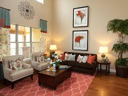 Coral Color Decorating Ideas by A Coral Colored Rug Pulls Together The Design In This Living Room