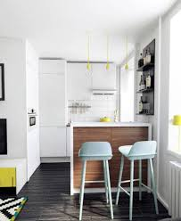 ApartmentSmall White Apartment Kitchen With Island Table And Wooden Floor Studio