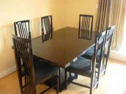 Simple Dining Room With UK Used Furniture Ideas Dark Wood Rectangular Table And Maple Hardwood Flooring