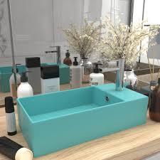 badezimmer waschbecken mit überlauf keramik hellgrün