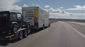 Driver Viewpoint U Haul Moving Truck Towing Car Passing Stock Video ...