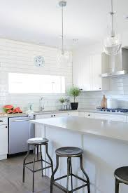 white and gray kitchen features white shaker cabinets adorned with