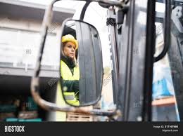 Female Forklift Truck Driver Image & Photo | Bigstock Women Truckers Network Replay Archives Real In Trucking Meet The Truckdriving Mom In A Business With Hardly Any Road To Zero Coalition Charts Ambitious Goal Reduce Traffic Posts By Rowan Van Tonder Transcourt Inc Industry Faces Labour Shortage As It Struggles Attract Nicole Johnson Monster Truck Driver Wikipedia Female Waiting For Loading Stock Photo Katy89 Driver Receives New Accidentfree Record Truck Using Radio Cab Closeup Getty Harassment Drivers Face And Tg Stegall Co Plenty Of Opportunity