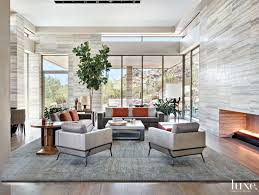 contemporary gray living room with travertine walls luxe