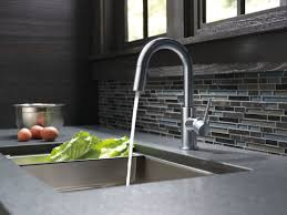Delta Trinsic Kitchen Faucet Champagne Bronze by Faucet Com 9959 Ar Dst In Arctic Stainless By Delta
