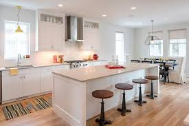 gorgeous transitional kitchen design features white flat front