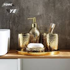 großhandel keramik wc sanitär ware artikel set 4 stück matt gold badezimmer zubehör set