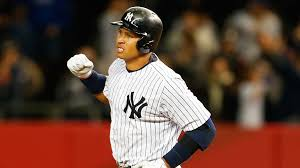 Alex Rodriguez of the New York Yankees pumps his fist after hitting a solo home run