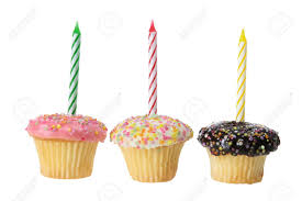 Cup Cakes with Birthday Candles on white Background Stock