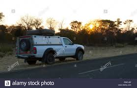 100 Pick Up Truck Tents Up Truck With Rooftop Tent Driving In Botswana Stock Photo