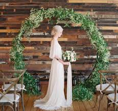 Ceremony Backdrop Eucalyptus And Globe Hanging Candle White Pillar Candles Surrounded By Matching Villasiena Indoor